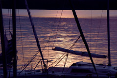 Sunset sail on a moonlit night (Paulina_77) Tags: light sunset sea sun sunlight lake reflection water sailboat reflections mirror golden pier boat nikon mood purple silhouettes atmosphere reflect hour sail dreamy nikkor tones lodz 18105 mirroring d90 sailinf 18105mm nikond90 zarzcin nikkor18105mm 18105mmf3556 nikkor18105mmf3556 pola77