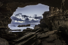 Looking Through (hayleyjones532) Tags: seascape clouds canon landscape rocks cave warrnambool shipwreckcoast rockshelf canon6d