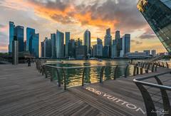 Gorgeous Sunset at Marina Bay (Leslie Hui) Tags: city sunset singapore cityscape cbd louisvuitton centralbusinessdistrict marinabay marinabarrage marinabaysingapore fullertonbayhotel