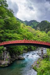 The Sacred Bridge (Pikaglace) Tags: bridge trees red sky green nature japan vertical river rouge rocks cloudy ninja sony rivire sacred pont nikko a7 sacr futarasan