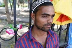 Portrait (Mayank Austen Soofi) Tags: boy portrait hairy man flower rose delhi chest plastic walla