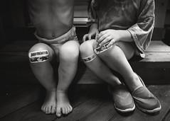 Jurassic World (trois petits oiseaux) Tags: kids sisters twins knees bandaids