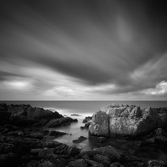 Looking Against the Wind (panfot_O (Bernd Walz)) Tags: longexposure sea blackandwhite bw seascape storm nature water monochrome landscape coast rocks wind fineart atmosphere balticsea shore contemplation bornholm waterscape ndfilter rockycoast outdoorphotography