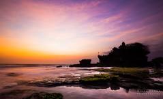 Tanah Lot Sunset (migalvanas) Tags: pink light sunset bali color colour reflection water clouds canon temple moss intense long exposure purple lot tanah migal