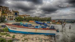 L'attente (Tra Te E Me (TTEM)) Tags: sky clouds photoshop gris boat moody ciel nuages aude roussillon hdr languedoc barques cameraraw lumixfz1000