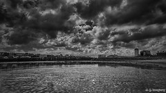 Black Middens (whistlingtent) Tags: white storm black beach clouds contrast reflections mono sand skies moody jetty north highlights shields lowlights