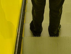 down the yellow escalator (dotintime) Tags: yellow bright glow down up escalator stair riser step ascend descend legs jeans feet sandals dotintime meganlane
