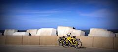 Duo (roberke) Tags: sky yellow clouds belgium bikes wolken lucht oostende geel fietsen beton flanders