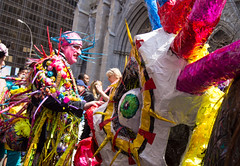 Easter parade (UrbanphotoZ) Tags: nyc newyorkcity ny newyork man costume colorful lashes manhattan stpatrickscathedral midtown cap eyeball greeneye eggs facepaint spikes papermache fifthave appendage redface spiderlegs