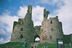 Castle gates (bigalid) Tags: castle film 35mm gate superia ruin plastic northumbria 400 april fujifilm xtra dunstanburgh 2016 c41 vuws superheadzwideandslim