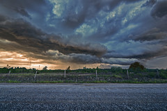 Blury roads under stormy sky's. (Hans J Fischer) Tags: sunset sky horses cats pets dogs nature beauty weather clouds sunrise landscape heaven natural wind hurricane fences dramatic storms drama tornado skys countryroads fenomina