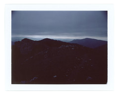 Before the night comes (Andrey Timofeev) Tags: camera sky mist mountains colour mamiya film nature misty fog clouds analog dark landscape polaroid back haze mood view cloudy horizon foggy deep atmosphere rangefinder 100mm iso pack rainy land instant fujifilm 100 universal analogue crimea vastness expiredfilm f35          mamiyasekor fp100c               08may2015  usebefore201502