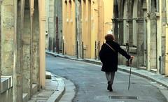 Ancient majorette training in the street (Croix-roussien) Tags: portrait urban lyon femme majorette rue façade nationalgeographic urbain
