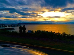 Mesmerized by a Puget Sound sunset (peggyhr) Tags: ocean sunset sky usa clouds reflections washington silhouettes vehicle pugetsound ferryterminal thegalaxy 25faves peggyhr thegalaxyhalloffame thelooklevel1red super~six☆stage1☆bronze naturestylep1c4 infinitexposurel1 artofimages~aoil1~