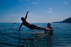 Flying (Mr Bultitude) Tags: mediterranean flying sea swimming fun maro spain boy woman