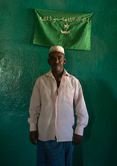 Sufi imam in front of islamic green flag, Harari region, Harar, Ethiopia (Eric Lafforgue) Tags: africa travel portrait people man color green vertical outdoors photography day adult african flag muslim islam traditional faith religion culture indoor unescoworldheritagesite unesco indoors spirituality ethiopia sufi sufism worshipper oneperson hornofafrica ethiopian harrar eastafrica placeofworship harar abyssinia arabiccalligraphy traditionalclothing lookingatcamera harari oromo onemanonly 1people harer harariregion hararjugol harergeprovince harergey ethio162912