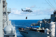 MH-60S Seahawks keep supplies moving from USNS Ranier to USS Mobile Bay during replenishment at sea (#PACOM) Tags: ocean usa pacific mob pacificocean cruiser underway deployment 2016 ussmobilebay cg53 7thfleet uspacificcommand pacom