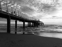 Lovely waters under the pier (elisabartolini) Tags: sea sky blackandwhite bw italy seascape love beach water monochrome architecture clouds reflections landscape outdoors pier seaside sand waves shadows wind horizon calm tuscany pillars bnw cloudscape versilia pontile blackwhitephotography underthepier waveporn skyporn distantview iphone6 bnwlovers lidodocamaiore