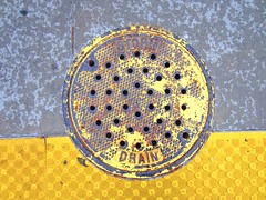 storm drain manhole with raindrops pattern (Zombie37) Tags: street city storm abstract texture colors look yellow metal contrast circle concrete grey design rust colorful iron paint industrial pattern bright random painted gray vivid ground down surface baltimore holes camo diamond drain plastic textures lookdown aviary manhole dots crisscross materials speckled stormdrain circular drab urabn