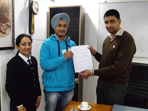 Jatinderpal Singh Receiving his AUS study visa from director