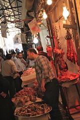 Butcher People and Street Food Aleppo The Ancient City That Was Nov 1 2010 Syria Middle East (eriagn) Tags: travel art history tourism wool rock fruit architecture concrete religious photography wooden traffic citadel minaret traditional prayer religion middleeast streetphotography documentary mosque tourist tourists unescoworldheritagesite traveller textures syria souk historical produce bazaar dailylife textiles fortification moat fortress weaving income citizens aleppo hawkers syrian bathhouse suq shopkeeper marked beliefs ngaire mosqueinterior ancientcity umayyadmosque orientalrugs camelhair medievalbuilding ceilingdecoration oldwalledcity citadelofaleppo traditionaltextiles eriagn ngairehart almadinasouq syrianstreetfood syrianpostbox