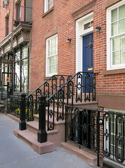 Iron fence and stoop railing, Charles Street, Greenwich Village, New York City (Spencer Means) Tags: city nyc usa ny newyork streets architecture buildings iron manhattan steps cities charles cast railings neighborhoods doorways greenwichvillage stoops hunkypunk newelposts spencermeans