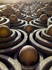 Alien Nursery (grzema) Tags: door sunlight metal golden alien greece ornaments eggs athina attica iphone korai iphone5c