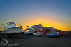 Spencer's Marina at sunset (Singing With Light) Tags: sunrise boats photography pier spring sony ct april 10th milford nautical duckpond 2015 ultrawideangle mirrorless upperduckpond singingwithlight singingwithlightphotography alpha6000 sonya6000 sony16mm28sel16f28 spencermarine