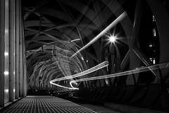 Ghost Train [explored] (Thomas Demeulemeester) Tags: bw byn night denhaag structure ghosttrain starburst longexplosure lightstreaks blackwandwhite urbannightscape