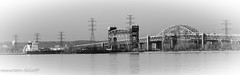 Light On the Bridge (maureen.elliott) Tags: bridge burlington landscape boat greatlakes blakcandwhite earlymorninglight lakefreighter burlingtonskyway lkaeontario