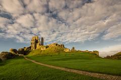 The golden castle (grbush) Tags: england castle grass clouds path ruin dorset corfe nationaltrust goldenhour purbeck ancientmonument corfecastle purbeckhills williamtheconquerer normancastle tokinaatx116prodxaf1116mmf28 sonyslta77