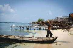 Guna fisherman in Panama (ROCIO Ysapy) Tags: travel sea water landscape fisherman photojournalism documentary bluesky panama indigenas pescador indigenous guna