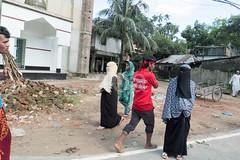 H504_3402 (bandashing) Tags: street trees red england people black green manchester watch crowd hijab logs covered niqab sylhet bangladesh carry mentalhealth socialdocumentary burkah aoa shahjalal bandashing akhtarowaisahmed treecuttingfestival lallalshahjalal