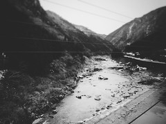 On the Train to Takayama 3 (Jon-F, themachine) Tags: blackandwhite bw mountain seascape mountains water monochrome japan rural river landscape asian landscapes countryside asia waterfront seascapes country olympus monochromatic rivers  nippon japo grayscale oriental orient fareast   gifu bodiesofwater bnw waterside nihon omd  japn 2016    nocolor m43  mft bodyofwater    mirrorless    micro43 microfourthirds  ft xapn jonfu  mirrorlesscamera snapseed   em5ii em5markii  giftken