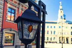 Town Hall Square and street decorative lights. Riga (Viktor Descenko) Tags: street old city detail art beautiful closeup architecture facade square lights town hall europe european decorative empty cities facades baltic architectural historic latvia lanterns historical towns riga blackheads vecriga