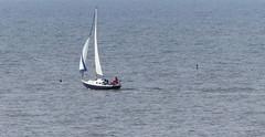 Lone yachtsman. (Les Fisher) Tags: yacht sheringham yachtsman offsheringham