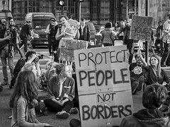 Migration HC9Q4852-1a (rodwey2004) Tags: westminster refugees protest streetphotography parliament demonstration solidarity migration society directaction immigration daffodils asylumseeker migrantworker humantrafficking diein migrantdeath blackcommunitiesmatter