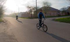Kids on bikes (Dimi Koan) Tags: street city bicycle kids evening bikes contrejour
