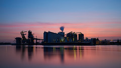Mercury Rising (McQuaide Photography (Away)) Tags: longexposure light holland reflection building industry water netherlands dutch amsterdam architecture zeiss outside licht twilight lowlight europe industrial outdoor dusk widescreen sony tripod nederland panoramic nd bluehour fullframe alpha 169 industrie manfrotto noordholland gebouw schemering 30seconds c1 cargill ndfilter 1635mm northholland phaseone variotessar captureone mirrorless sonyzeiss 6stop mercuriushaven mcquaidephotography a7rii ilce7rm2 captureonepro9