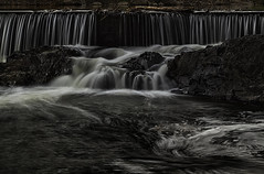 Falling Through The Cracks [EXPLORE: 5/14/16] (Wilkof Photography) Tags: longexposure november autumn trees winter light sunset shadow reflection nature wet water overgrown pool night rural creek canon river dark lens landscape outside evening countryside waterfall md rocks stream waterfront darkness natural cloudy hiking pennsylvania postcard rustic perspective scenic rocky maryland windy overcast panoramic farmland falls explore pa boulders gettysburg le nd backcountry serene roadside polarizer habitat backroads picturesque cascade cpl vantage marshcreek creekbed topography ndfilter neutraldensity 64mm 18135mm cumberlandtownship canont4i wilkofphotography