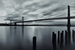 Bay Bridge in Mono (Rebecca Ang) Tags: sanfrancisco california longexposure bridge bw usa water monochrome sunrise baybridge embarcadero sanfranciscooaklandbaybridge