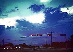 Red Light Resplendence (johnnyp_80435) Tags: sky clouds trafficlight bluesky redlight pflugerville
