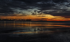 Last Light Of Venice (Wilkof Photography) Tags: ocean california ca longexposure winter light sunset shadow sea sky seascape reflection beach nature wet water skyline architecture canon dark lens landscape outside mirror golden evening coast pier seaside sand rocks colorful surf waves waterfront nightshot sundown natural cloudy dusk horizon perspective shoreline scenic shell overcast panoramic symmetry pacificocean socal le shore nd land seashell venicebeach lowtide 24mm southerncalifornia hazy polarizer picturesque cloudcover beachfront cpl lowangle oceanfront ndfilter venicepier oceanscape neutraldensity 18135mm canont4i wilkofphotography