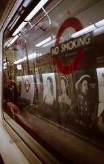 Tube (kat-ward) Tags: city travel colour london film window analog 35mm underground lomo lomography snapshot transport tube lofi olympus trainstation analogue filmcamera olympusxa2 charingcross expiredfilm c41 filmphotography