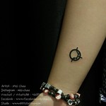 Tiny Symbol Tattoo