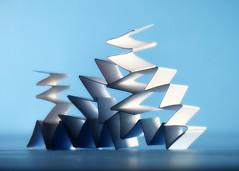 Zig Zag Pile (nikagnew) Tags: blue light shadow white paper structure stack pile folded zigzag creased accordionfold macromondays