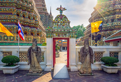 Wat Pho, an ancient remains important of Thailand with sunbeams (brize99) Tags: house man art home church beautiful stone architecture century asian thailand temple gold design big ancient arch exterior view bangkok buddha thing flag faith religion chinese peaceful charm molding holy thai sacred flare ornate wat pho majestic brass a7 amulet sunbeams 2015