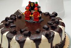 ferrari crew on tiramisu (captchaos) Tags: red cake miniature lego sweet chocolate flag ferrari plastic crew icing tiramisu blocks figures checkered dripping
