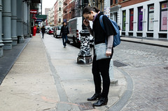 (zenjazzygeek) Tags: street city people woman spring eyes closed day discomfort hunched