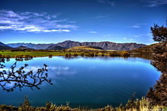 I'm gonna just sit here...forever (Kevin_Jeffries) Tags: new travel blue light newzealand panorama lake reflection art nature beautiful beauty flickr pretty postcard natur scenic clarity tranquility bluesky clear wanaka tranquil kevinjeffries goeographic